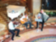 The X-Trio instrumental group entertains on the Piazza of the Crown Princess cruise ship