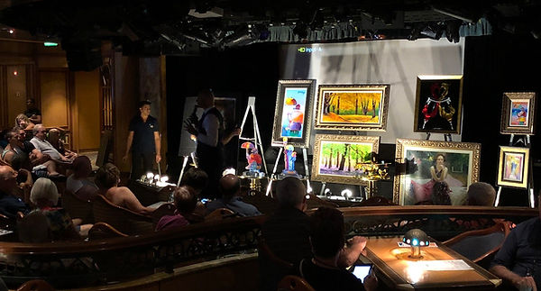 Paintings or prints displayed on stage  at the Princess Fine Art Auction Scam