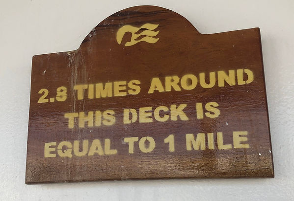 """Sign: """"2.8 Times Around This Deck Is Equal to 1 Mile"""" -- Promenade Deck on the Crown Princess"""
