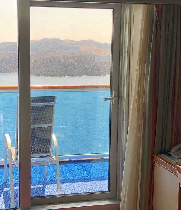 Cruise ship balcony view from inside the stateroom