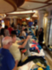 T-Shirt Sale -- passengers mob the tables to get $10 shirts