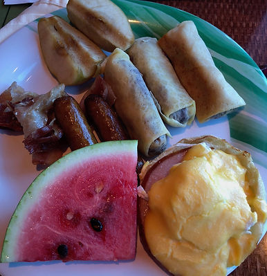 Horizon Breakfast Buffet on the Crown Princess -- bacon, sausage, blintzes, baked apple, watermelon, an eggs benedict