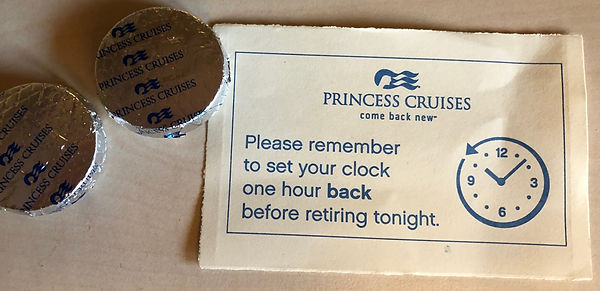 Cruise ship cabin steward leaves behind choclates and a time-zone, time-change reminder on Princess Cruises' Crown Princess