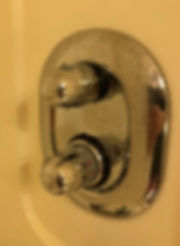 Stateroom shower controls -- pressure and temperature