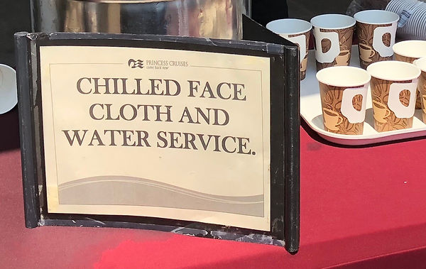 Princess offers chilled face coth and water service to passengers waiting to tender back to the Crown Prnicess