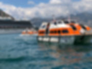 Crown Princess uses its lifeboats as tender boats in th Bay of Kotor, Montenegro