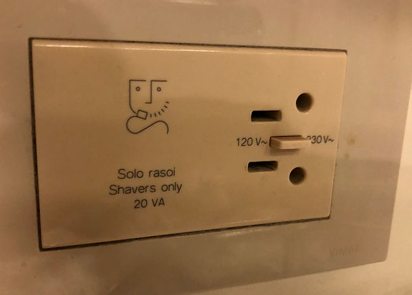 Bathroom electrical outlet, dual American and European, in a cruise ship stateroom restrrom