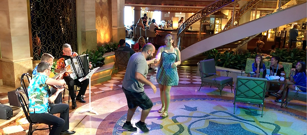 A couple dances on the Crown Princess cruise ship's Piazza