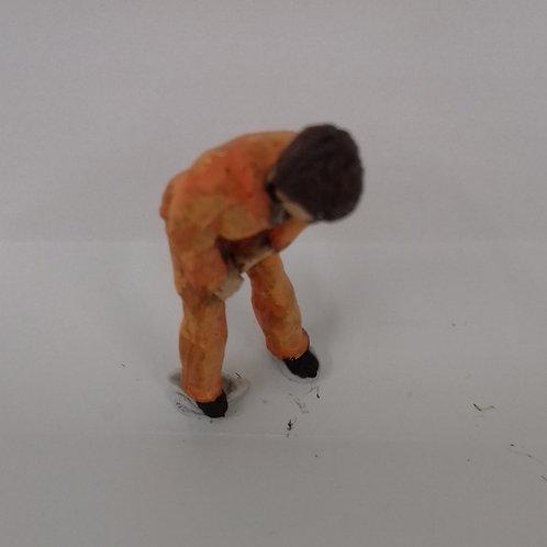 O Gauge Workman in Overalls Bending Over