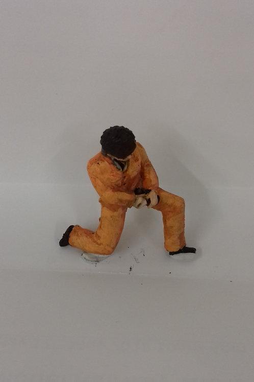 O Gauge Workman in Overalls Kneeling Down