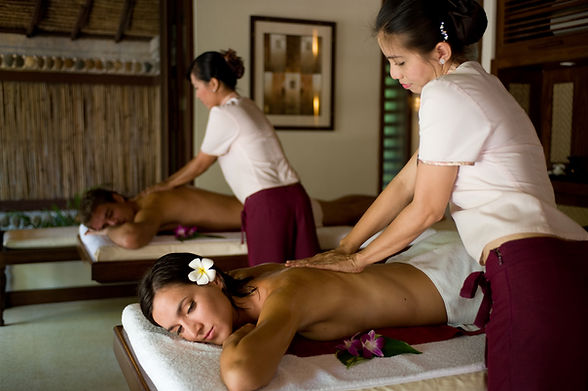 A young couple receiving massage treatme
