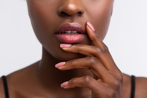 Shiny lip gloss. Close up of young Afric