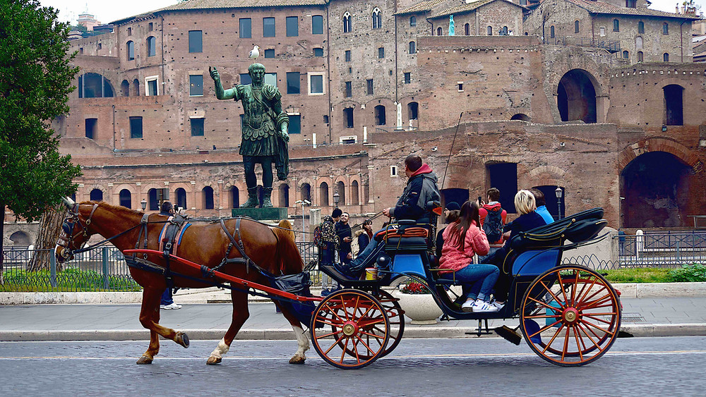 A ride on via dei Fori Imperiali, near the Colosseum. Photo on a Rome by Day, Beauty and History Photo Tour by Giulio D'Ercole
