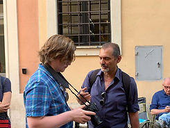 Giving a hands on photography workshop during a Rome by Day street photography photo tour by Giulio D'Ercole of Rome Photo Fun Tours.