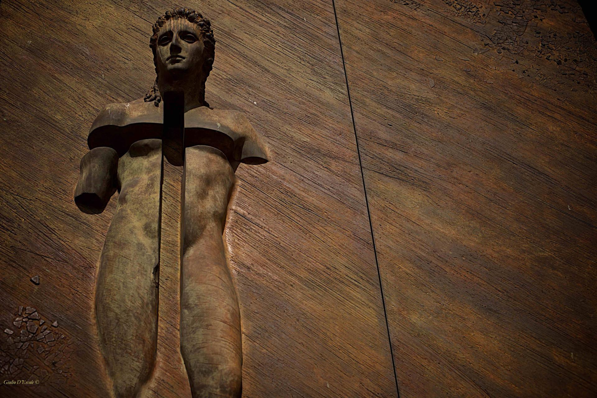 Bronze door with Christian Martyr figure