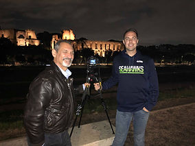 Posing with a client with the Roman ruins in the background on a Rome by Night Photo Tour Under the Stars provided by Giulio D'Ercole.