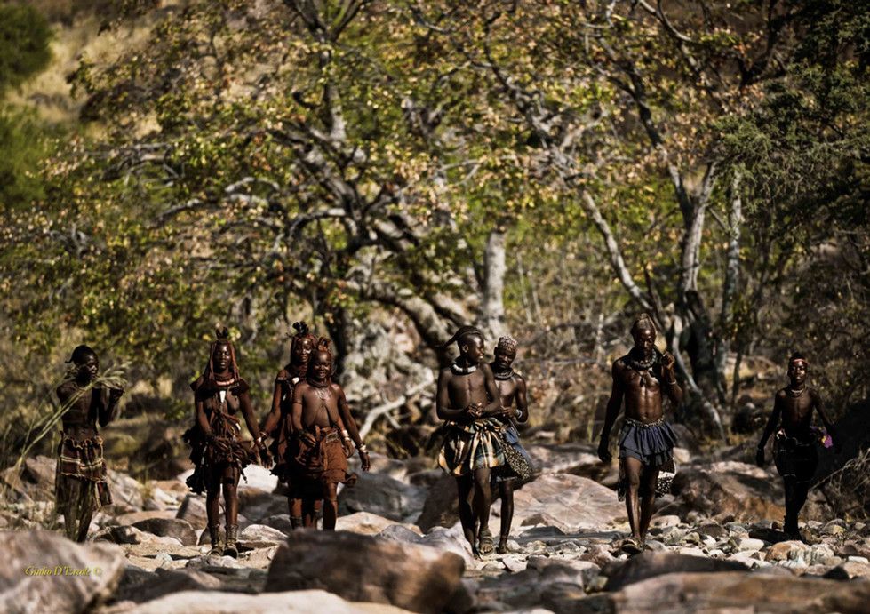 Himba men and women in the nature
