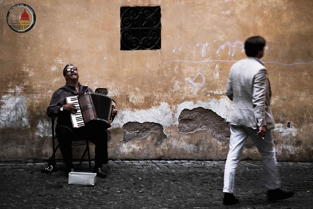 Street photography is the ability to observe, to be in the moment and to capture life as it happens. Photo by Giulio D'Ercole, Rome Photo Fun Tours