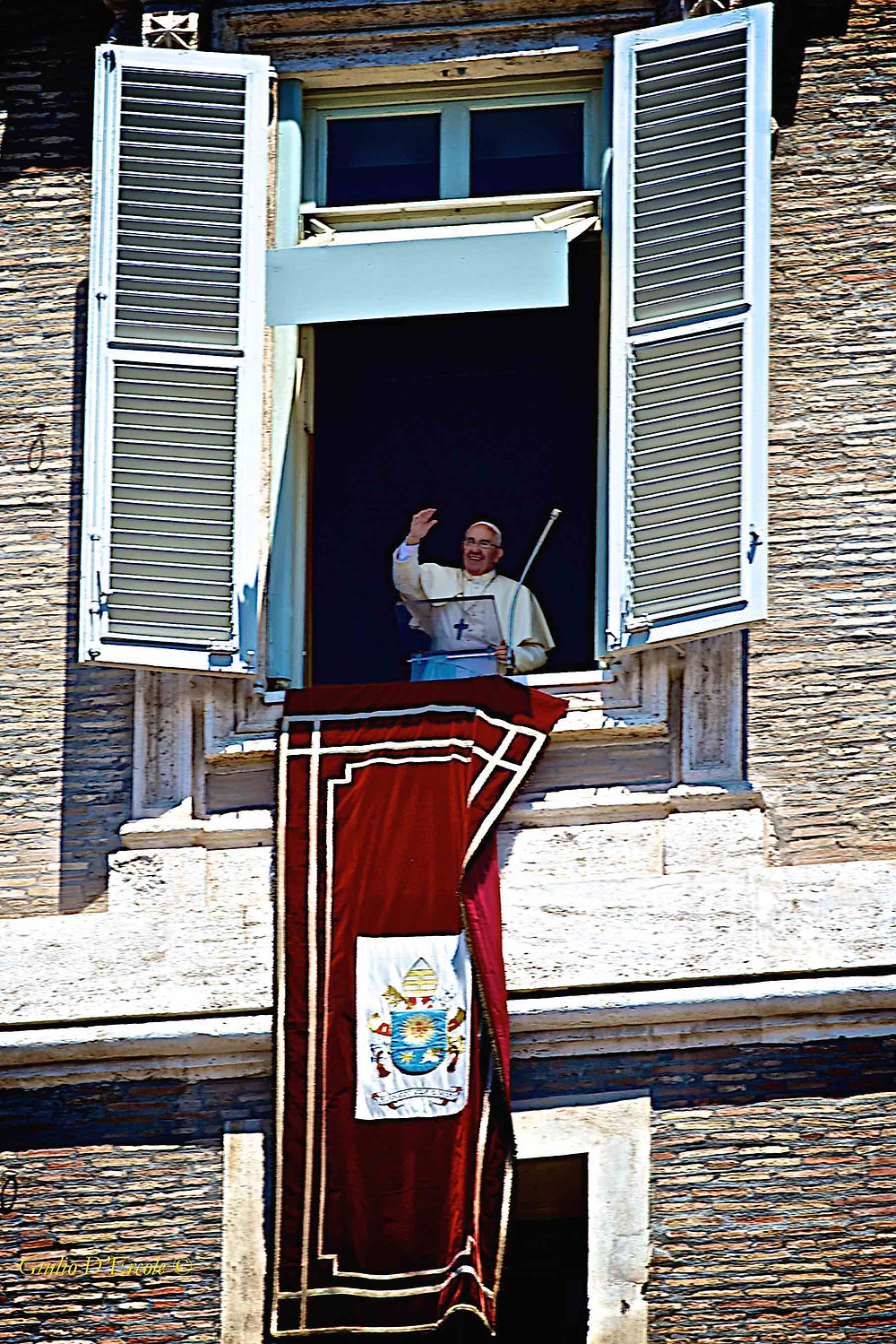 Pope Francis greets the crowd in St. Peter's Square. Photo by Giulio D'Ercole, Rome Photo Fun Tours on a Rome by Day Photo Tour