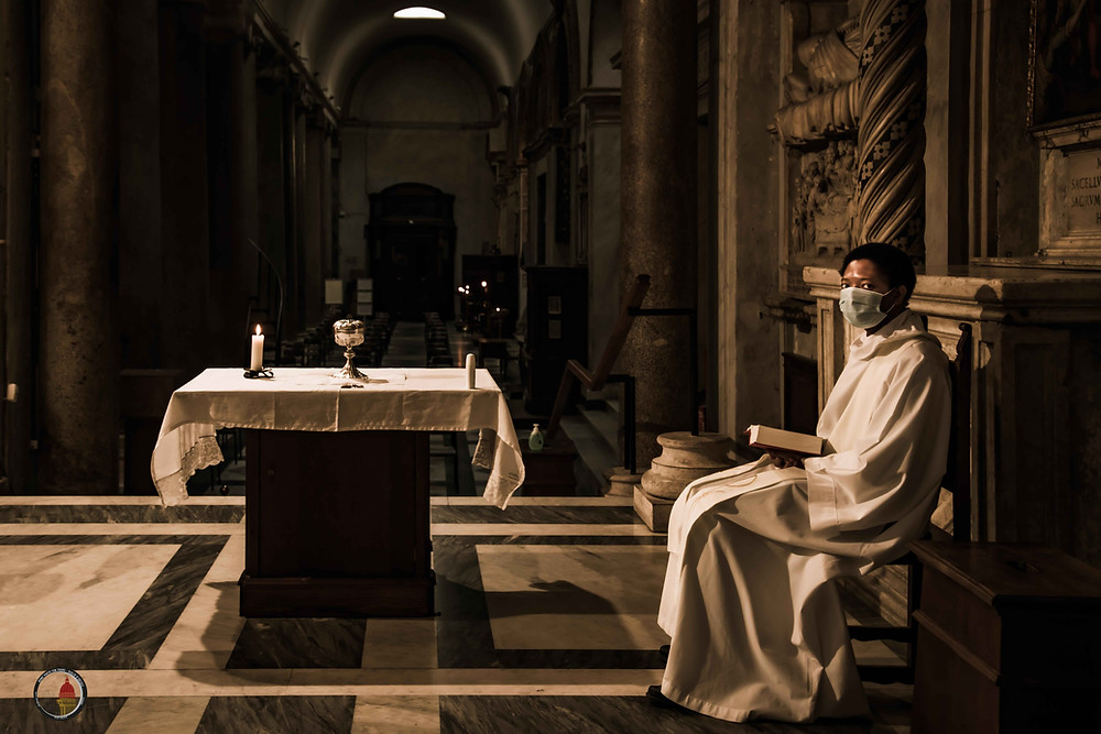 A priest in Santa Maria in Trastevere, in Rome, at the times of lockdown.