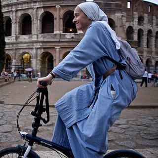 A biking nun at the Colosseu, Rome