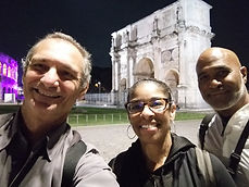 Clients posing happily  at the Constantine's Arch on a Rome by Night Photo Tour Under the Stars, by Giulio D'Ercole of Rome Photo Fun Tours