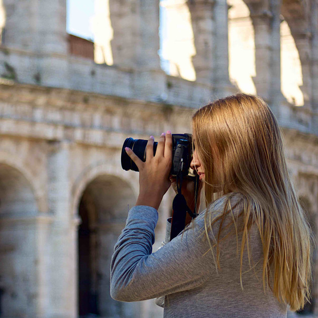 Client Photographing the Colosseum