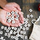 spelling-game-letter-tiles-in-hand.jpg