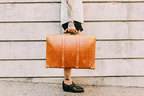 woman-holds-vintage-suitcase.jpg