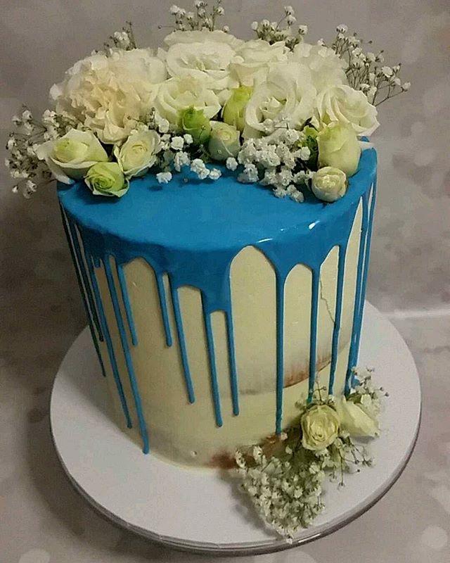 Gorgeous baptism cake for Mateo__#blue #dripcake #florals #baptismcake #pemulwuycupcakes #cakesofins