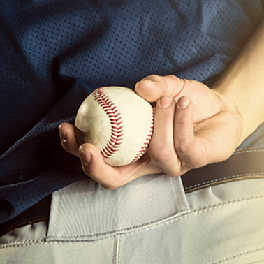 Pitcher holding ball behind back.png