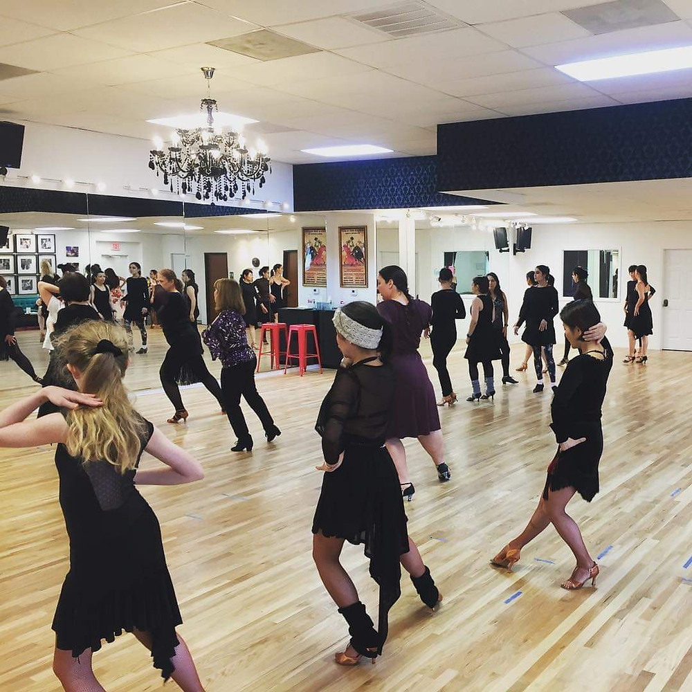 Learning ballroom dancing in a group class setting.