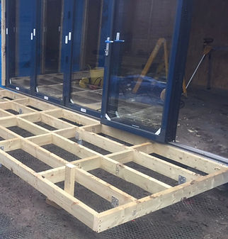 timber-raft-on-ground-screws-next-to-bi-