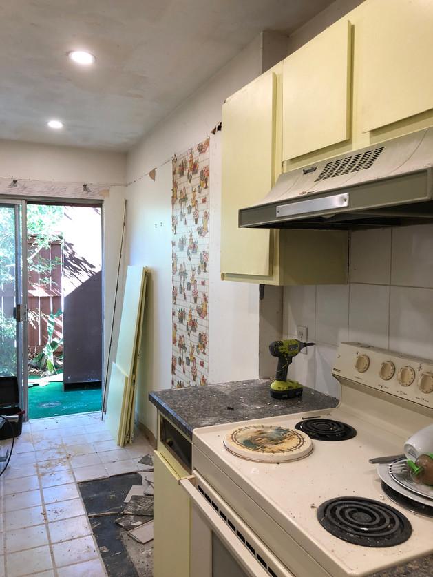 Kitchen before - big cabinet gone