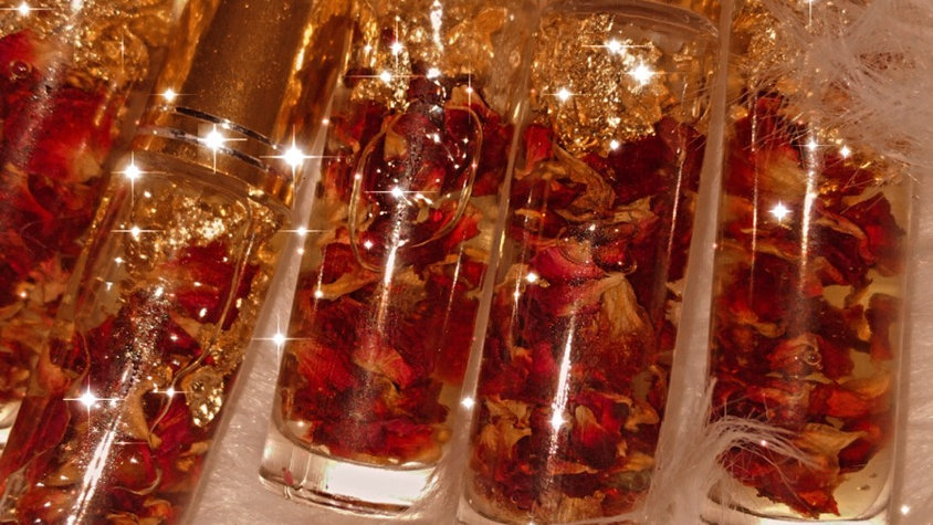 Hydrating lip oil infused with dried roses and gold flakes