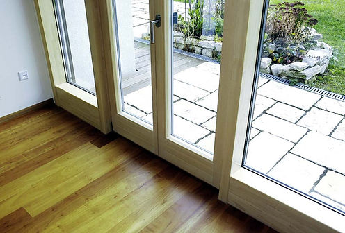Double glazed timber French doors made by ThermaDura.