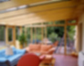 Double glazed timber sliding door installed in a sunroom, conservatory.