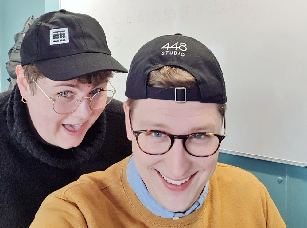 two people wearing hats taking a selfie