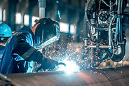 man welds at the factory.jpg