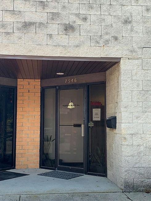 Office door for Capstone MGT Inc. at 7546 Reliance St, Worthington, Ohio.