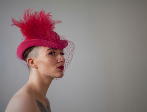 Pink feather riding hat with veil