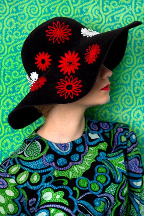 Black felt capeline with floral detail