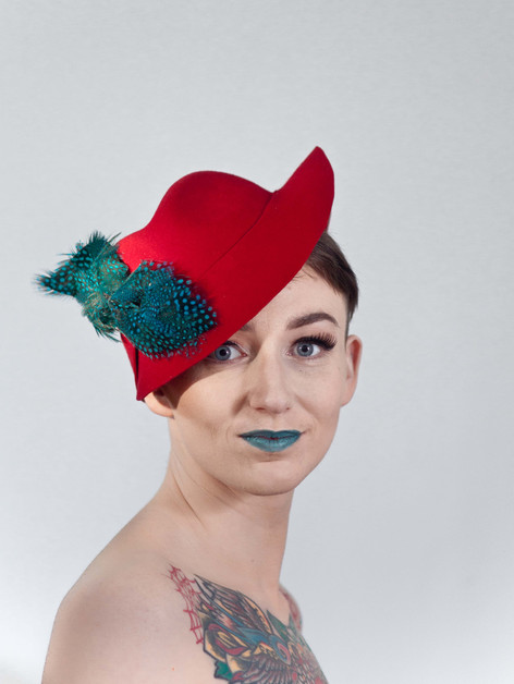 Red trilby with blue feathers