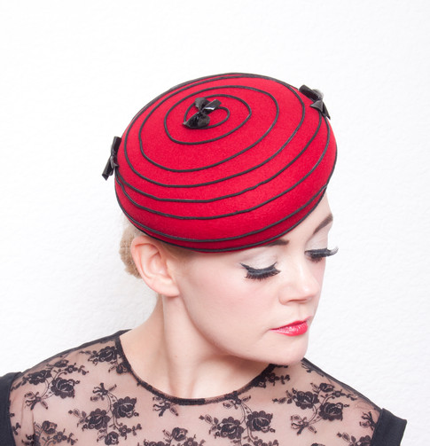 Red felt beret with black piping