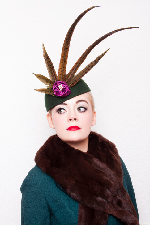 Green felt and pheasant feather hat