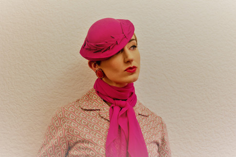 Pink felt hat with arrow detail