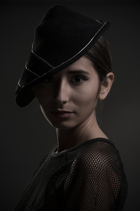 Black felt hat with silver detail
