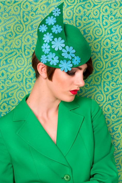 Green felt hat with blue daisy detail