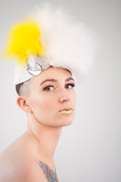 White and yellow feather hat