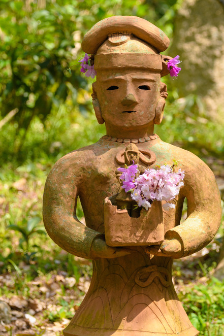 Earthen Figure with Flowers